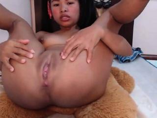 Asian girl with vibrating dildo masturbating