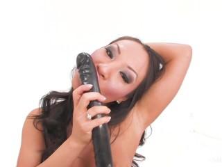 Asa Akira toys her holes with a double dildo
