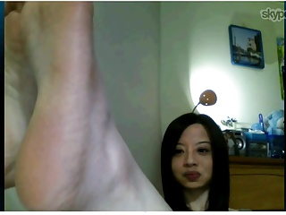 Taiwanese woman shows feet on Skype