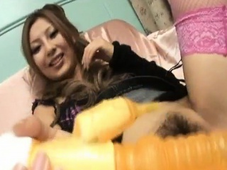 Japanese milf Shiho Kano fucks her hairy twat with a big toy