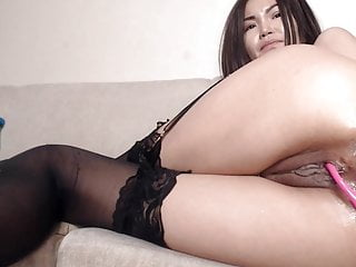 Asian fucks her acquisitive pussy and wet asshole with huge toy