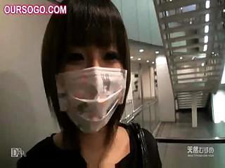 Asian babe alongside a mask is poked plus rubbed alongside some toys