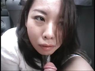 Asian cutie Yuka Ono gives head to the brush boyfriend in the automobile
