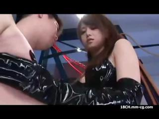 Naughty Asian dominatrix strokes his tool and gives him a strapon fuck