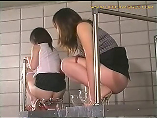 Group of oriental schoolgirls use the teacher's throat as their water closet and make water it all jointly