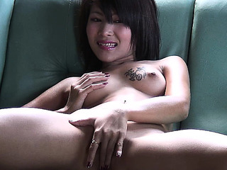 Hawt Oriental cutie positions on the daybed and diddles and toy copulates
